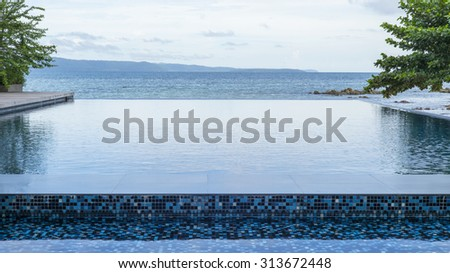 Swimming pool near the beach at high class resort in thailand
