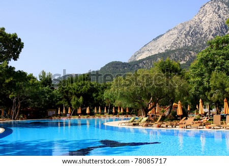 Swimming pool on a sunny day - stock photo