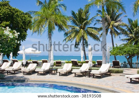 Swimming pool on a sunny day.Pattaya city in Thailand .