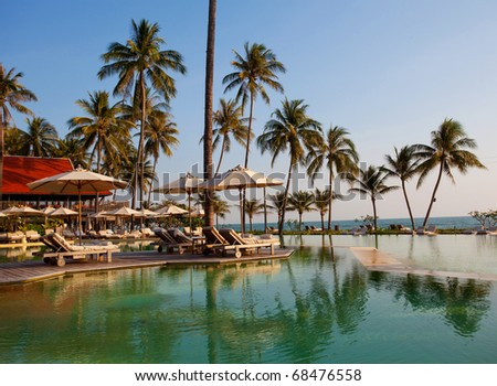 Swimming pool on the beach in Thailand - stock photo