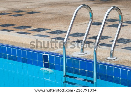 Swimming pool stair. - stock photo