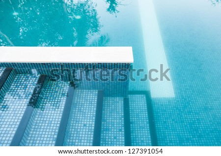 swimming pool step - stock photo