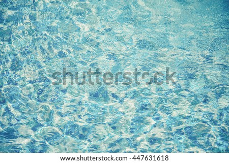 Swimming pool water. Aqua texture (Vintage filter effect used) - stock photo