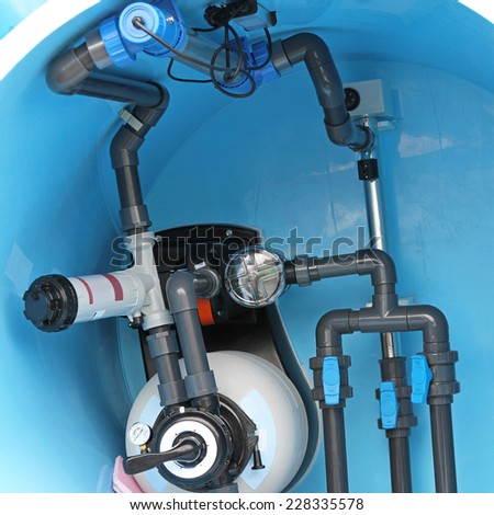 Swimming pool water plumbing fittings and utilities - stock photo