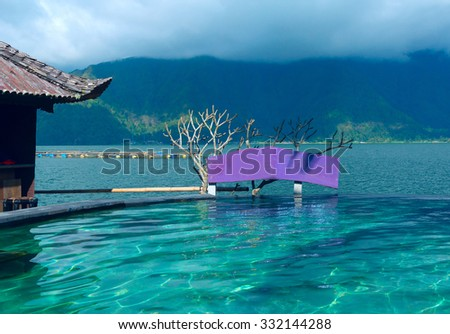 Swimming pool with a view of the mountain - stock photo