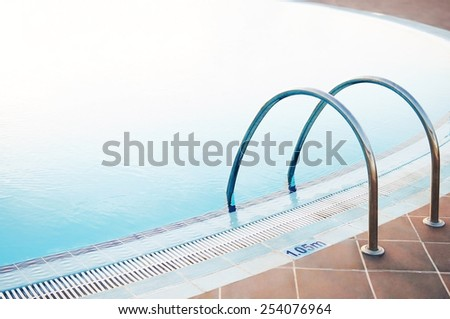 Swimming pool with blue water in holiday resort. - stock photo