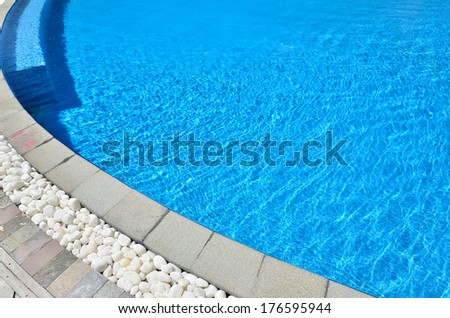 Swimming pool with clear pool water  - stock photo