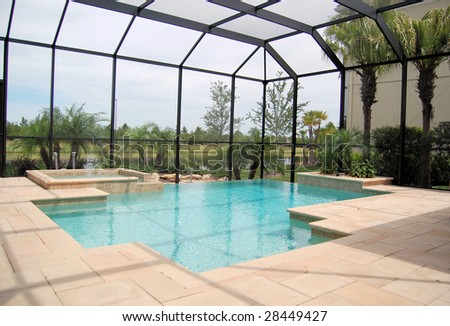 Swimming pool with negative edge and cage