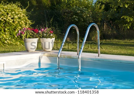 Swimming pool with pool steps - stock photo
