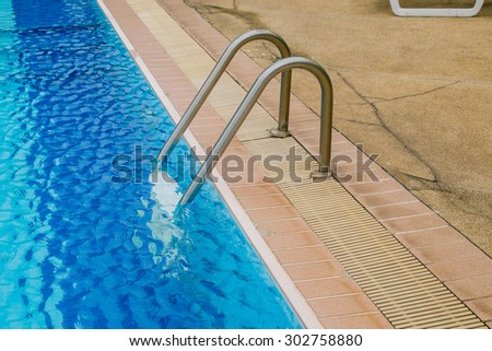 Swimming pool with stair at hotel.