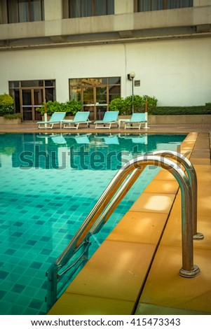 Swimming pool with stair at hotel - Vintage Tone.