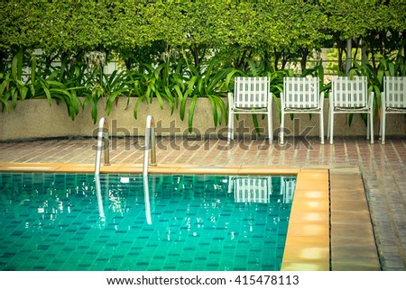 Swimming pool with stair at hotel. - Vintage Tone.
