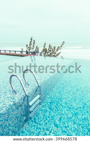 Swimming pool with stair in hotel pool resort - Vintage Filter - stock photo