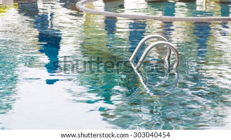 Swimming pool with stairs - stock photo