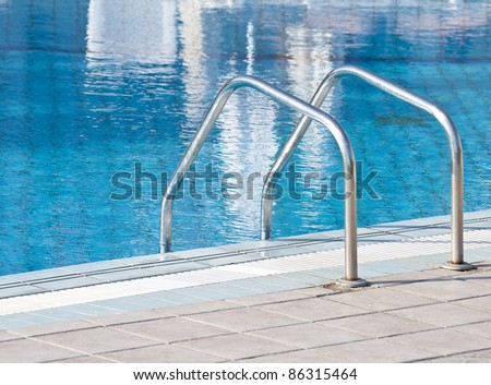 Swimming pool with stairs close up