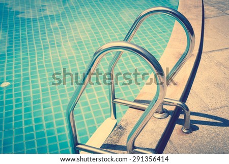 Swimming pool with stairs ( Filtered image processed vintage effect. ) - stock photo