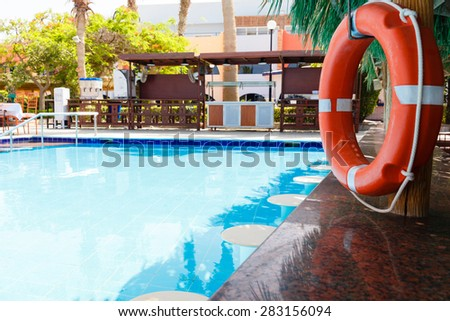 swimming pool with sun beds to tourists on the - stock photo