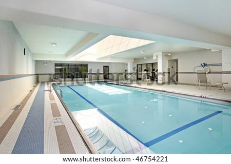 Swimming pool with swim lanes in condominium building - stock photo