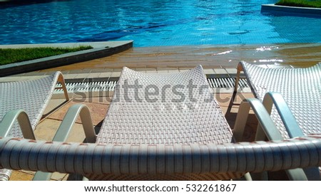 swimming pool with the beach in the background (low view)