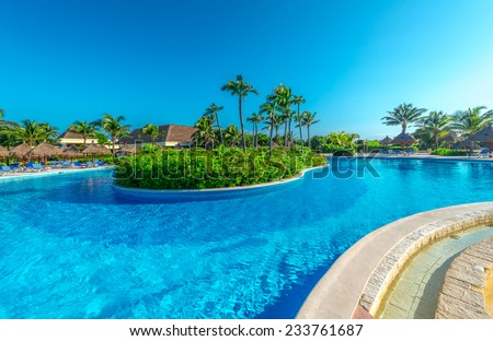 Swimming pool with the island at the luxury, caribbean, tropical, mexican resort.