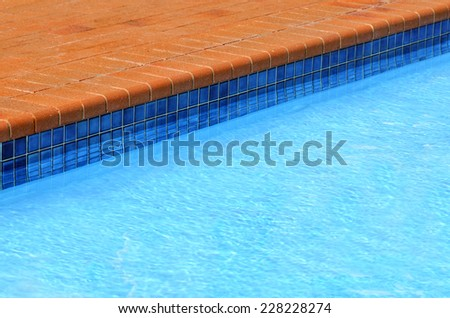 swimming poolside. travel and vacation concept.Background with copy space - stock photo