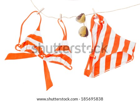 swimming suit with glasses hanging on rope  isolated on white background - stock photo