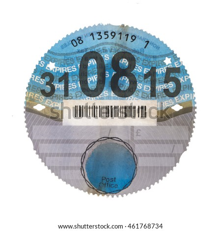 SWINDON, UK - AUGUST 2, 2016: Old UK Car Tax Disk on a White Background