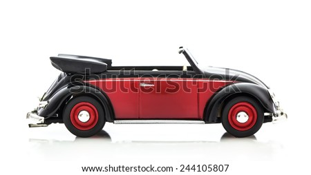 SWINDON, UK - DECEMBER 14, 2014: Convertible VW Beetle in Red and Black, Die cast model on a white background.