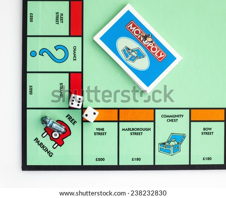 SWINDON, UK - DECEMBER 17, 2014: English Edition of Monopoly showing Free Parking,  The classic trading game from Parker Brothers was first introduced to America in 1935.