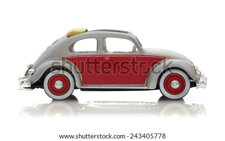 SWINDON, UK - DECEMBER 14, 2014: Retro VW Beetle in Silver and Red with White wall Tyres, Die cast model on a white background. - stock photo