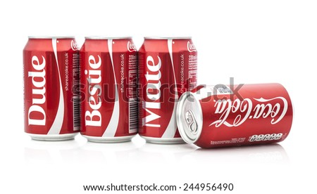 SWINDON, UK - JANUARY 18, 2015: Cans of Coca-Cola, Share a Coke With Dude, Bestie, Mate on a white background produced for the Share a Coke promotion - stock photo