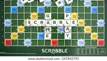 SWINDON, UK - JANUARY 28, 2015: Scrabble Word Game showing the playing board, Scrabble is made by Mattle