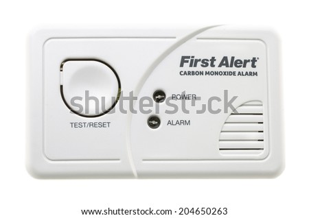 SWINDON, UK - JULY 13, 2014:  First Alert CO Carbon Monixide Alarm on a White Background