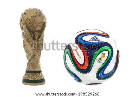 "SWINDON, UK - JUNE 11, 2014: FIFA World Cup Trophy and Adidas Brazuca Football on a white Background,  ""FIFA World Cup Trophy"", was introduced in 1974. Made of 18 carat gold with a malachite base - stock photo"