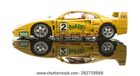 SWINDON, UK - MAY 31, 2015: Yellow Ferrari F40 in race trim on a white background - stock photo