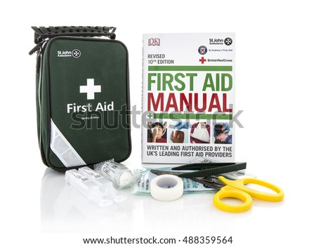 SWINDON, UK - SEPTEMBER 25, 2016: St John Ambulance First Aid Kit and Manual on a white background