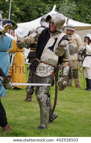 SWINESHEAD, UNITED KINGDOM - JUNE 26: Three historical reenactors dressed as medieval knights take part in a display in the King John's pageant held near the abbey where King John was poisoned in 1216
