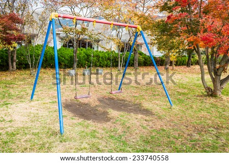 swing for kid in the park - stock photo
