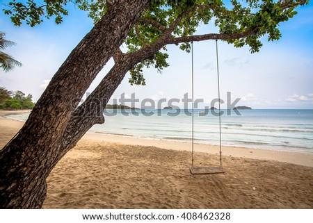 Swing hanging under the tree at tropical beach, Phuket, Thailand - stock photo