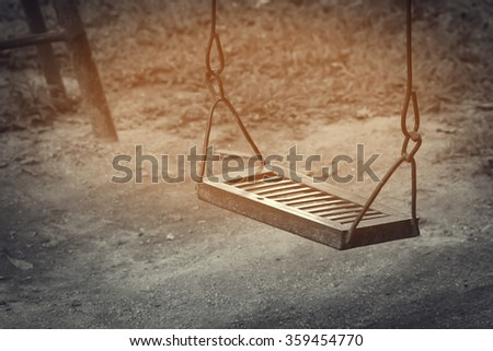 swing in the playground made from steel ,image in soft focus