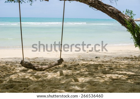 swing on beach sand and sea in Koh Samet Thailand - stock photo
