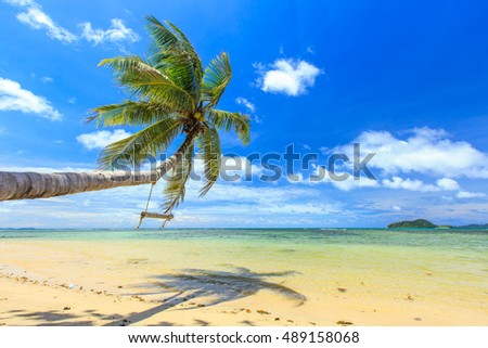 Swing on the beach and blue sky