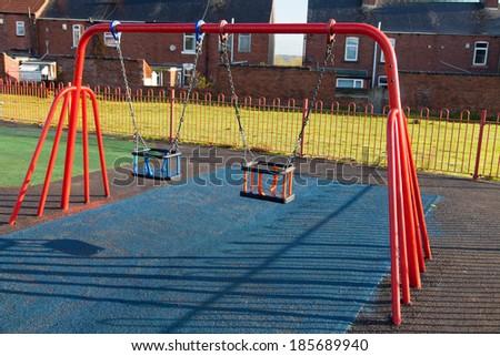 Swing on the playground - stock photo