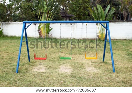 Swing set on the playground - stock photo