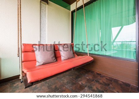 swing sofa furnish, and leather pillow for decoration and relax at balcony - stock photo