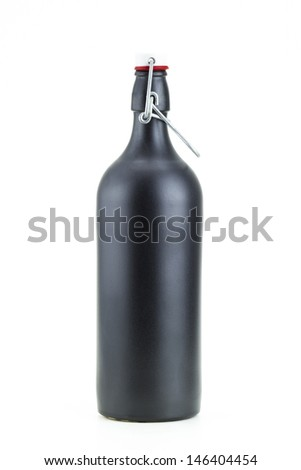 swing top black clay bottle of beer