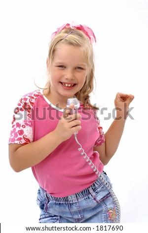 Swinging and singing pretty girl - stock photo