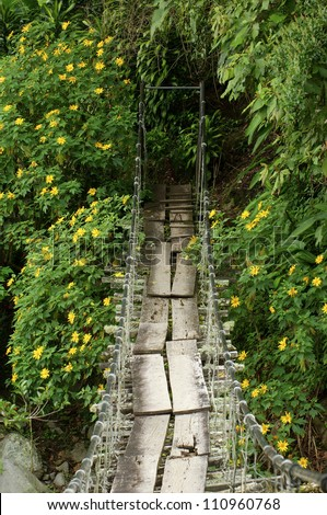 Swinging bridge over river, Boquete, Chiriqui province, Panama, Central America - stock photo