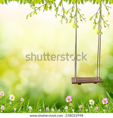 Swings in the garden flowers bokeh abstract light background  - stock photo