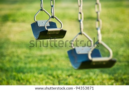 Swings on a playground - stock photo